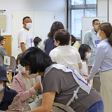 新型コロナワクチンの集団接種に協力